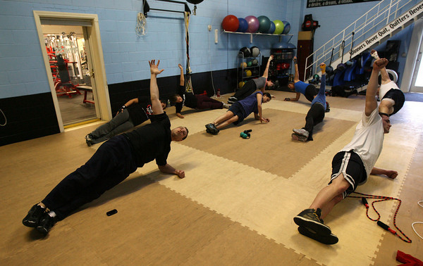 Gloucester: Aldo Telliccia of Aldo's Fitness leads a cardio kickboxing class yesterday evening. Aldo says they have been training police officers and members of the city council in addition to a new program that focuses on young athletes age 9-12. Photo by Kate Glass/Gloucester Daily Times