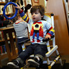 Manchester: Turner Valeo plays the tambourine during Mother Goose Story Time at the Manchester Public Library yesterday morning. Photo by Kate Glass/Gloucester Daily Times