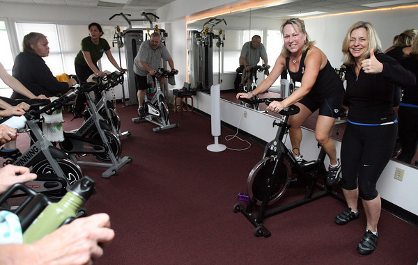 "Essex: Carol Figurido, a breast cancer survivor, leads a portion of a spinning class fundrasier, ""Spin for Hope,"" with with fellow instructor, Jean Grobe, right, at Transform Fitness Studio on Sunday. Twenty-five riders took turns riding between 9 and noon to raise money for the American Cancer Society. Last year's fundraiser brought in $5,000 and donations are still coming in for Sunday's event. Photo by Kate Glass/Gloucester Daily Times"