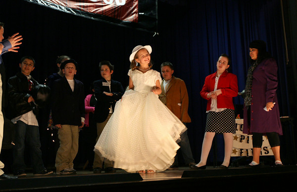 "Gloucester: Sarah Werner, who plays Cindy Lou in East Gloucester Elementary School's production of ""Going Going Gone with the Breeze,"" is introduced to the press during a scene from the play.The show ran over the weekend, but the cast did a final performance for the other students at the school on Monday. Photo by Kate Glass/Gloucester Daily Times"