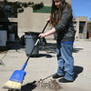 Gloucester: Kayleigh Crabb, a member of the Student Council at O'Maley Middle School, sweeps the front walkway during a spring cleanup yesterday afternoon. Photo by Kate Glass/Gloucester Daily Times