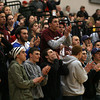 Gloucester: Gloucester fans, including boys basketball captains Mike Tomaino and Adam Philpott, cheer on the girls basketball team during their 66-62 victory over Reading on Thursday. They will play Arlington Catholic in the Division 2 North Finals at the Tsongas Arena in Lowell tonight at 6. Photo by Kate Glass/Gloucester Daily Times