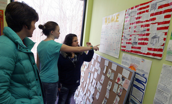 Gloucester: Jade Barry and Rikki Johnson, both 7th grade students at the Gloucester Community Arts Charter School, describe history projects their class has been working on as they give a tour of the school during an open house yesterday morning. Photo by Kate Glass/Gloucester Daily Times