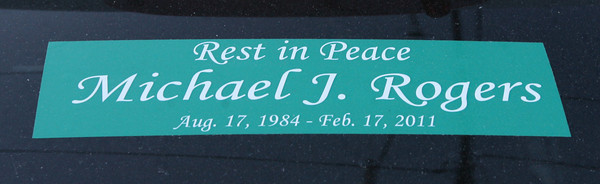 A sticker remembering Michael Rogers, who died of a heroin overdose.