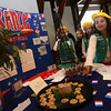 "Gloucester: Macey Oliver describes pork rillettes her girl scout troop prepared to represent France during Girl Scouts of Cape Ann ""Thinking Day"" at City Hall on Thursday. Each troop researched a country and what girl scouts of that country do differently in addition to preparing samples of the country's food. Photo by Kate Glass/Gloucester Daily Times"