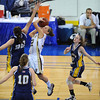 Lowell: Gloucester Hannah Cain drives to the basket Arlington Catholic in the division 2 North Finals at the Tsongas Arena Saturday night in Lowell. Desi Smith/Gloucester Daily Times.
