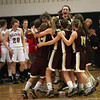Gloucester guard Audrey Knowlton leaps above her teammates as they celebrate their 66-62 win over Reading during the MIAA Division 2 North Semi-Finals at Woburn High School last night. Photo by Kate Glass/Gloucester Daily Times