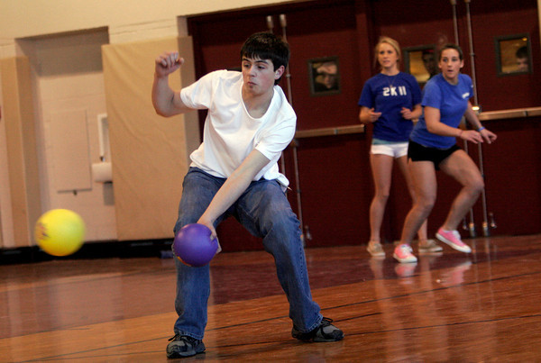 Rockport: Rockport High School senior Zak Kennedy knocks away a ball as Kelsey Keough and Emma Littlefield keep an eye on their opponent during a game of dodge ball after school yesterday. Photo by Kate Glass/Gloucester Daily Times