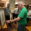 Rockport: Former Rockport High/Middle School Principal Charles Symonds presents George Ramsden with a portrait done by Luisa Cleaves that will hang in the Middle School library. Ramsden had worked in the Rockport schools for 44 years and retired in 2008. Photo by Kate Glass/Gloucester Daily Times