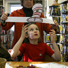 Essex: Essex Librarian Deborah French helps Maggie Gould put on her Dr. Seuss hat as the TOHP Burnham Library celebrates the birthday of the famous author on Thursday. Photo by Kate Glass/Gloucester Daily Times