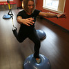 Rockport: Nicole Gomez recently opened Studio G in Rockport, which offers small classes focusing on core strength as well as personal training. Here she demonstrates a suspended lunge on bosu. Photo by Kate Glass/Gloucester Daily Times