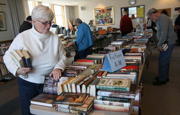 "Rockport: Carol Gray peruses the fiction titles for sale at the Rockport Public Library's ""Cabin Fever Book Sale,"" which was held over the weekend. All proceeds benefit library programs and infrastructure. Photo by Kate Glass/Gloucester Daily Times"