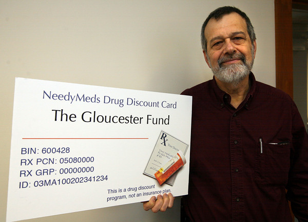 Gloucester: Dr. Richard Sagall, President of NeedyMeds, shows a model of their Gloucester Fund drug discount card, which helps people pay for prescription medicines. Photo by Kate Glass/Gloucester Daily Times
