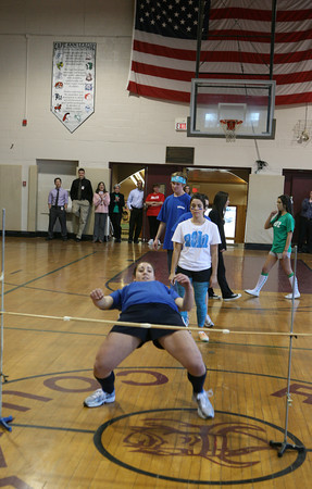 AMY SWEENEY/Gloucester Daily Times.<br /> Sabrina McCarthy competes in the limbo for her senior class during the Rockport Spirit Week Final Assembly. The seniors were the winners overall.