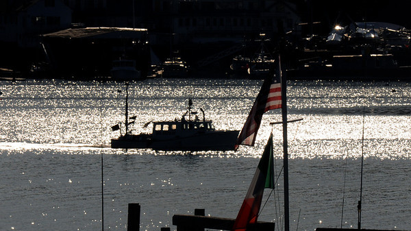 Gloucester:  A boat heads out Monday morning as sunshine sparkles off the waters of Gloucester Harbor. JIm Vaiknoras/Staff photo