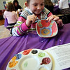 "ALLEGRA BOVERMAN/Staff photo. Gloucester Daily Times. Gloucester: Plum Cove Elementary School kindergartener Sophia Siveria paints a bowl during the school's after school program on Tuesday afternoon. About 30 bowls were painted there by students and the program coordinators for The Open Door Empty Bowl Dinner that will take place on Thurs. May 10 from 4-8 p.m. at Cruiseport Gloucester. See the website for more information: <a href=""http://www.foodpantry.org"">http://www.foodpantry.org</a> ."