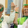 ALLEGRA BOVERMAN/Staff photo. Gloucester Daily Times. Gloucester: Dolores Clancy, left, and her friend Fran Ciaramitaro, both of Gloucester, were decked out in St. Patrick's Day finery during the St. Patrick's Day Party at Rosie's Cafe in the Rose Baker Senior Center on  Thursday.