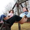 ESSEX—First-graders Cindy Heights, right, and Faith Ellis swing together after school in the playground at Essex Elementary School. Jesse Poole/Gloucester Daily Times March 14, 2012