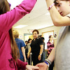 Fifth-grader Justin Wilson, right, dances with his classmate Carrie Stone at Beeman Elementary School as guest dance instructor Tina LaFlam watches their progress on Wednesday morning. Jesse Poole/Gloucester Daily Times March 7, 2012