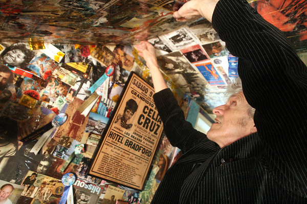 ALLEGRA BOVERMAN/Staff photo. Gloucester Daily Times. Gloucester: Willie Alexander of Gloucester adds clear packing tape to his sprawling collages.
