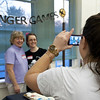 Essex: Hillary French takes a photo of her mom Debbie French (left) who runs the library, and April Wanner who was on hand to help with Hunger Games Thursday night at TOHP Public Library, Martin St.  Desi Smith/Gloucester Daily Times. March 22,2012