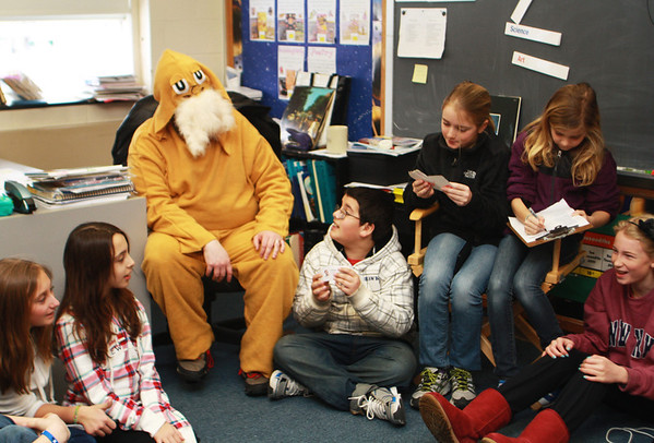 Joe McDonough, fifth-grade teacher at Manchester Memorial Elementary School, dresses as the Lorax in celebration of Read Across America and Dr. Suess's birthday on Friday, and rounds up his students to sign a reading pledge. Jesse Poole/Gloucester Daily Times March 2, 2012