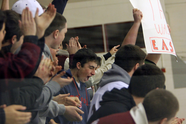 ALLEGRA BOVERMAN/Staff photo. Gloucester Daily Times. Chelmsford: Rockport lost  6-2 to Bedford at the Chelmsford Forum Ice Arena on Thursday night.  Fans from Rockport react to the first goal they scored.
