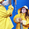Fourth-grader Cyrus Baumgaertel, left, and third-grader Morgan McGuire wear fishermen's clothing and hold fishing tools in front of the third, fourth and fifth graders of West Parish School as Schooner Adventure sponsors an educational outreach program about the history of Gloucester. Jesse Poole/Gloucester Daily Times March 16, 2012