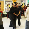 Fifth grade students watch their teacher Annemarie Wentzell dance with local dance instructor Tina LaFlam at Beeman Elementary School on Wednesday morning. Jesse Poole/Gloucester Daily Times March 6, 2012