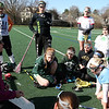 ALLEGRA BOVERMAN/Staff photo. Gloucester Daily Times. Gloucester: The Manchester-Essex Girls Varsity Lacrosse coach, Sarah Holch, far left, talks strategy with the team during practice on Tuesday afternoon at Field Field in Manchester.