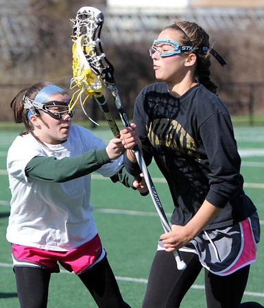 ALLEGRA BOVERMAN/Staff photo. Gloucester Daily Times. Gloucester: Manchester-Essex Girls Varsity Lacrosse players Diana Grimes, left, and Kaitlin Cochand in action during practice on Tuesday afternoon at Field Field in Manchester.
