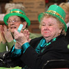 ALLEGRA BOVERMAN/Staff photo. Gloucester Daily Times. Gloucester: During the St. Patrick's Day Party at Rosie's Cafe in the Rose Baker Senior Center on Thursday. Lee Harty, left, and Susan Galatis, right, both of Gloucester, were enjoying themselves.