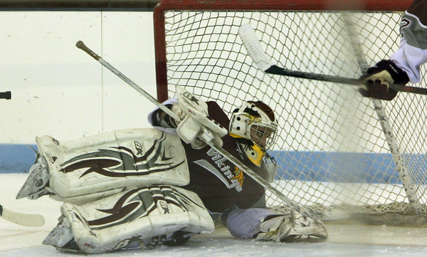 ALLEGRA BOVERMAN/Staff photo. Gloucester Daily Times. Chelmsford: Rockport lost  6-2 to Bedford at the Chelmsford Forum Ice Arena on Thursday night.  Goalie Colby Foster in action.