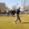 Essex: Kenny Ryan tees off at Cape Anne Golf Club in Essex Monday under the watchfull eyes of playing partners, Larry Ingersoll, Bob Briand, and Dick Tarr. Although the course generally opens around this time every spring ,  golf never stopped at the club this year because of the warm winter. Jim Vaiknoras/staff photo