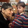 "ALLEGRA BOVERMAN/Staff photo. Gloucester Daily Times. Manchester: Dorothy Ganick of Manchester, a pediatrician in Lynnfield and a hematology oncology specialist, read stories to children during the story hour at Manchester Public Library on Tuesday afternoon. She read ""Biscuit Visits the Doctor,"" ""ABC Doctor,"" and ""Doctor Maisy."" She also answered questions from the children and showed them a few of her instruments including a stethoscope, otoscope and reflex hammer. The children made their own little doctor's bags afterwards. She lets WIll Burke, 4, listen with a stethoscope to the beating of his own heart."