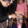 "ALLEGRA BOVERMAN/Staff photo. Gloucester Daily Times. Manchester: Dorothy Ganick of Manchester, a pediatrician in Lynnfield and a hematology oncology specialist, read stories to children during the story hour at Manchester Public Library on Tuesday afternoon. She read ""Biscuit Visits the Doctor,"" ""ABC Doctor,"" and ""Doctor Maisy."" She also answered questions from the children and showed them a few of her instruments including a stethoscope, otoscope and reflex hammer. The children made their own little doctor's bags afterwards. Sveta Piasecki, 4, gets her reflexes tested for fun by Ganick."