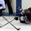 ALLEGRA BOVERMAN/Staff photo. Gloucester Daily Times. Chelmsford: Rockport lost  6-2 to Bedford at the Chelmsford Forum Ice Arena on Thursday night. Rockport's Jake O'Maley in action at right.