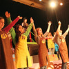 "ALLEGRA BOVERMAN/Staff photo. Gloucester Daily Times. Gloucester: From left to right are Ooompa Loompas Erica Knowlton, SooAe Ono, Kelly Broe, Rosalia Favazza and Hope Stewart in the upcoming O'Maley Middle School production of ""Willy Wonka Junior."" Behind them, top, is Madison Smith, as Willy Wonka."