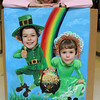 ALLEGRA BOVERMAN/Staff photo. Gloucester Daily Times. Tina Lamond, who works at Rockport Elementary School, with her Leprechaun cutout that she painted by hand and will be used for photos during the schools's first Lucky Leprechaun St. Patty's Day Dance set for 5 p.m. to 8 p.m. on Friday evening at the school. Her children, Sam, left, a third grader, and Natalie, a first grader. Cost to attend is $5 per  child. Hair feathers are $12, the photo booth is $1. Children in grades K-2 attend from 5-5:30 p.m. and Children in grades 3-5 attend from 6:30 - 8 p.m.