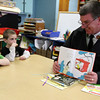 "ALLEGRA BOVERMAN/Staff photo. Gloucester Daily Times. Gloucester: Gloucester Fire Chief Steve Aiello reads several books to students in Lisa Morgan's class at Veterans Memorial Elementary School on Friday. About 13 ""local celebrities"" were on hand to read to every classroom in the school."