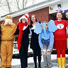 The teachers of Manchester Memorial Elementary School dressed up on Friday as characters from Dr. Suess's books. From left, Joseph Gugino, Joseph McDonough, Samantha Silag, Jennifer Fawson, Tyler Wood, Katie Garvin and Jenna Seymour, stand outside to welcome students to a day full of celebrating Read Across America and Dr. Suess's birthday. Jesse Poole/Gloucester Daily Times March 2, 2012