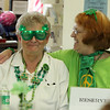 ALLEGRA BOVERMAN/Staff photo. Gloucester Daily Times. Gloucester: Dolores Clancy and her friend Fran Ciaramitaro, rigth, both of Gloucester,<br /> were decked out in St. Patrick's Day finery during the St. Patrick's Day Party at Rosie's Cafe in the Rose Baker Senior Center on Thursday.