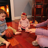 ALLEGRA BOVERMAN/Staff photo. Gloucester Daily Times. Wilmington: Two of the three Vestal family children have urea cycle disorder, a rare illness they are managing. From left, Michael, 3, and Marisa, nine months old, who both have this condition, play with their older sister Mia, 7. A benefit will be held for the second year on March 24 that will go towards the National Urea Cycle Foundation.