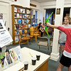 Essex: Kristen Harding 12, takes aim at President Snow of Panem with a bow and arrow, as Alexi Woodward looks on at The Hunger Games Thursday night at TOHP Public Library, Martin St.  Desi Smith/Gloucester Daily Times. March 22,2012