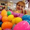 ALLEGRA BOVERMAN/Staff photo. Gloucester Daily Times. Gloucester: Christine Orlando, owner of Kids Unlimited and a member of the Gloucester Downtown Association, with 1,000 Easter eggs that will be distributed during the Easter Egg Run on April 7 downtown.