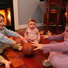 ALLEGRA BOVERMAN/Staff photo. Gloucester Daily Times. Wilmington: Two of the three Vestal family children have urea cycle disorder, a rare disease that they are managing. From left, Michael, 3, and Marisa, nine months old, who have it, playing with their older sister Mia, 7. A benefit will be held for the second year on March 24 that will go towards the National Urea Cycle Foundation.