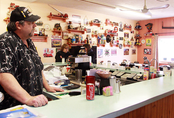 GLOUCESTER—David Tucker, owner of Tucker's Farm Family Dinner at 67 Maplewood Ave., stands behind the counter on Wednesday afternoon for what was one of his last days to do so, as the cozy restaurant is closing at the end of this coming weekend. Jesse Poole/Gloucester Daily Times March 14, 2012
