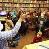 Left and in the hat, Sara Collins, children's librarian at Manchester Public Library, reads a couple books by Dr. Suess in celebration of the author's birthday on Friday. Jesse Poole/Gloucester Daily Times March 2, 2012