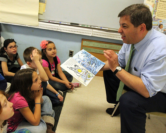 "ALLEGRA BOVERMAN/Staff photo. Gloucester Daily Times. Gloucester: Sen. Bruce Tarr reads to second graders in Caerrie Salie's class at Veterans Memorial Elementary School on Friday. About 13 ""local celebrities"" were on hand to read to every classroom in the school."