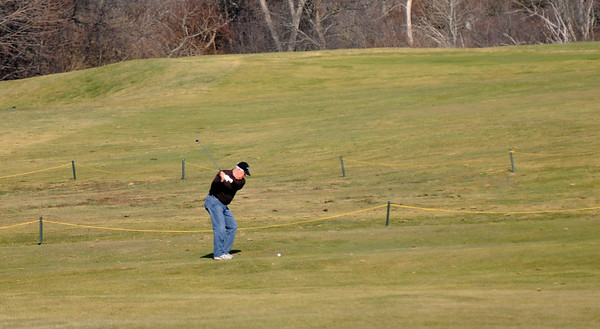 Essex: Bob Briand hits a fairway shot at Cape Anne Golf Club in Essex Monday Although the course generally opens around this time every spring, golf never stopped at the club this year because of the warm winter. Jim Vaiknoras/staff photo<br /> , Essex: Bob Briand hits a fairway shot at Cape Anne Golf Club in Essex Monday Although the course generally opens around this time every spring, golf never stopped at the club this year because of the warm winter. Jim Vaiknoras/staff photo